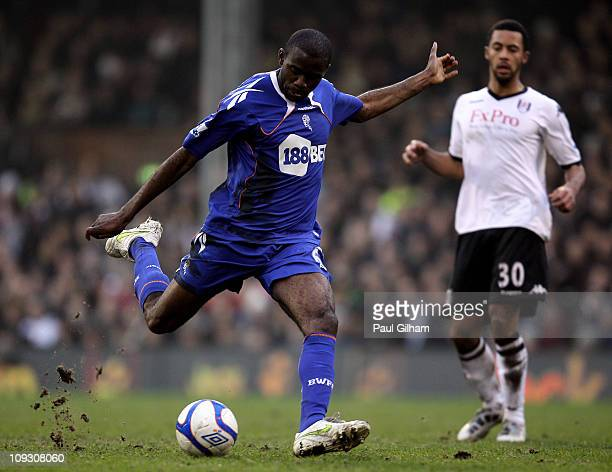 Fabrice Muamba of Bolton fires a shot as Mousa Dembele of Fulham looks on during the FA Cup sponsored by EON 5th Round match between Fulham and...