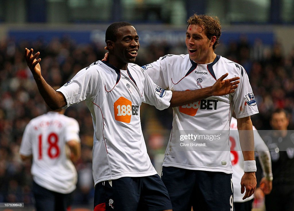 <a gi-track='captionPersonalityLinkClicked' href=/galleries/search?phrase=Fabrice+Muamba&family=editorial&specificpeople=745514 ng-click='$event.stopPropagation()'>Fabrice Muamba</a> of Bolton Wanderers celebrates scoring the opening goal with his team mate <a gi-track='captionPersonalityLinkClicked' href=/galleries/search?phrase=Johan+Elmander&family=editorial&specificpeople=553763 ng-click='$event.stopPropagation()'>Johan Elmander</a> (R) during the Barclays Premier League match between Bolton Wanderers and Blackburn Rovers at the Reebok Stadium on December 12, 2010 in Bolton, England.