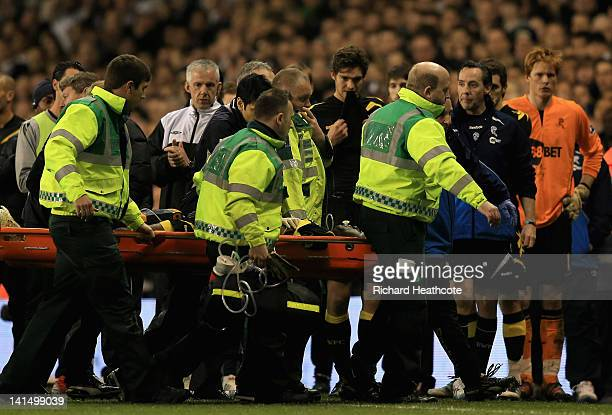 Fabrice Muamba of Bolton Wanderers is taken off on a stretcher still unconscious after receiving CPR treatment on the pitch after suddenly collapsing...