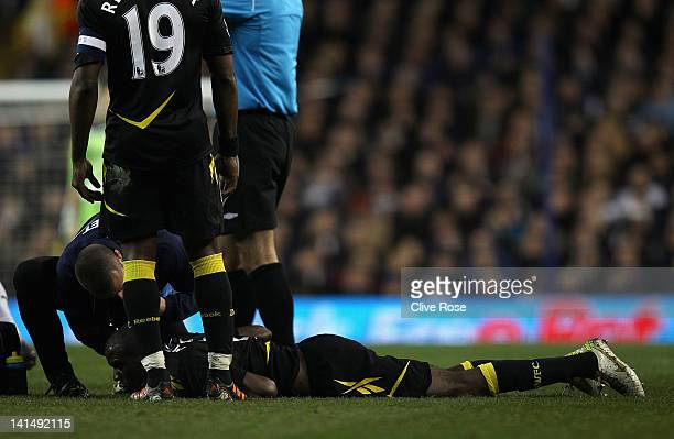 Fabrice Muamba of Bolton Wanderers lies injured on the pitch during the FA Cup Sixth Round match between Tottenham Hotspur and Bolton Wanderers at...