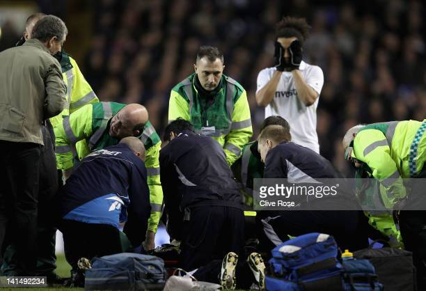 Fabrice Muamba of Bolton Wanderers receives CPR treatment on the pitch after suddenly collapsing during the FA Cup Sixth Round match between...