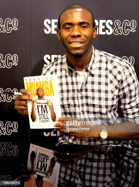 Fabrice Muamba signs copies of his new book 'I'm Still Standing' at The Trafford Centre on November 15 2012 in Manchester England