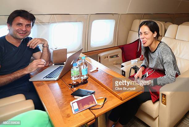Fabrice Santoro and Ana Ivanovic of the Indian Aces relax on the private players flight from DelhiIndia to Dubai prior to the CocaCola International...