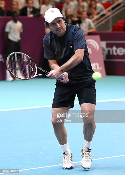 Fabrice Santoro in action during the Amelie Mauresmo Tennis Night to benefit the 'Institut Curie' to fight cancer during the 22nd Open GDF Suez held...