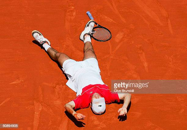 Fabrice Santoro of France celebrates after winning the longest ever match in tennis history in his first round match against Arnaud Clement of France...