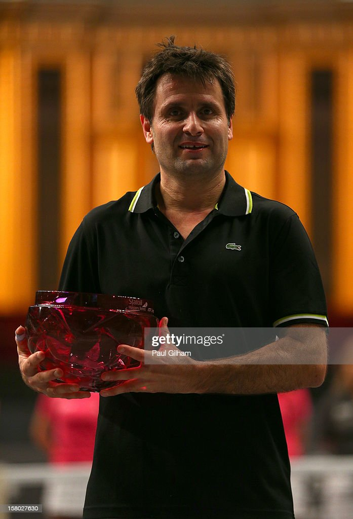 Fabrice Santoro of France celebrates with the trophy after winning the ATP Champions Tour Final between Tim Henman of Great Britain and Fabrice Santoro of France during the Statoil Masters Tennis at Royal Albert Hall on December 9, 2012 in London, England.