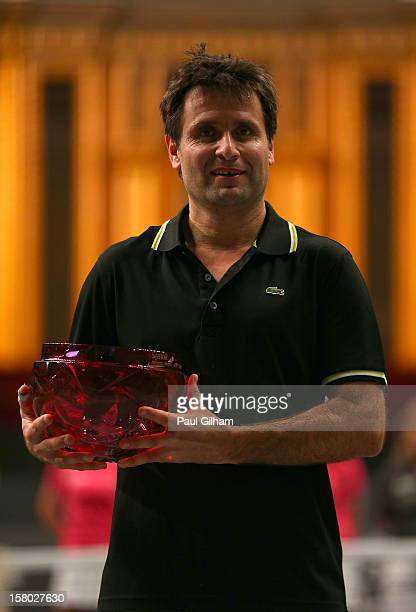 Fabrice Santoro of France celebrates with the trophy after winning the ATP Champions Tour Final between Tim Henman of Great Britain and Fabrice...