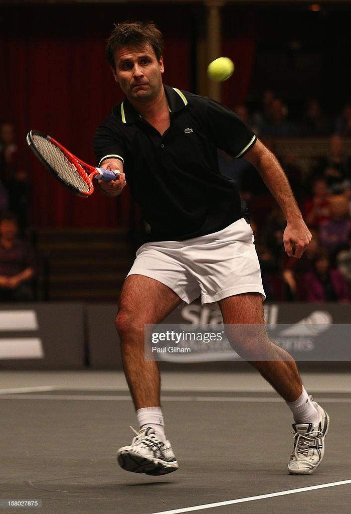 Fabrice Santoro of France in action during the ATP Champions Tour Final between Tim Henman of Great Britain and Fabrice Santoro of France during the Statoil Masters Tennis at Royal Albert Hall on December 9, 2012 in London, England.