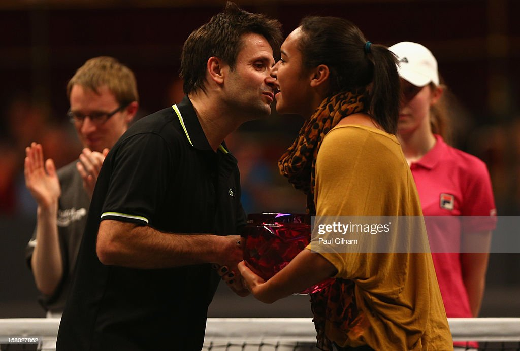 Fabrice Santoro of France is presented with the winners trophy by Heather Watson of Great Britain after winning the ATP Champions Tour Final between Tim Henman of Great Britain and Fabrice Santoro of France during the Statoil Masters Tennis at Royal Albert Hall on December 9, 2012 in London, England.