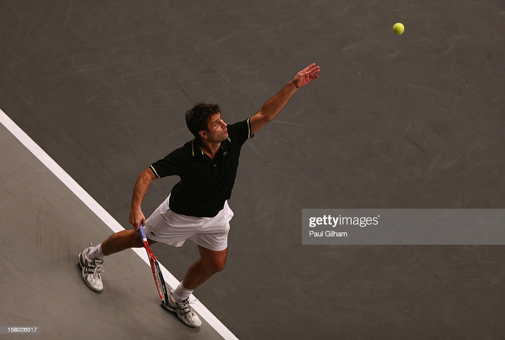 Fabrice Santoro of France serves during the ATP Champions Tour Final between Tim Henman of Great Britain and Fabrice Santoro of France during the Statoil Masters Tennis at Royal Albert Hall on December 9, 2012 in London, England.