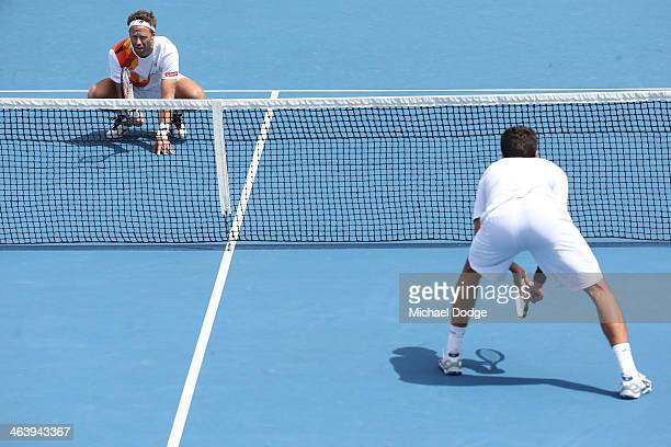 Fabrice Santoro of France watches the serve in his third round doubles match with Lukasz Kubot of Poland against Ivan Dodig of Croatia and Marcelo...