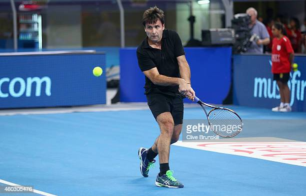 Fabrice Santoro of the Indian Aces in action against Patrick Rafter of the Singapore Slammers during the CocaCola International Premier Tennis League...