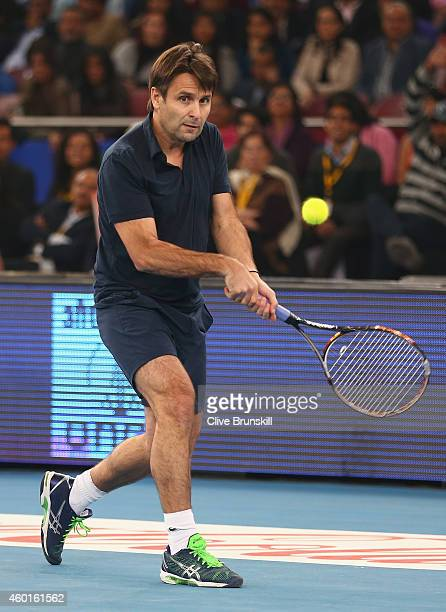 Fabrice Santoro of the Indian Aces plays a backhand against Goran Ivanisevic of the UAE Royals during the CocaCola International Premier Tennis...