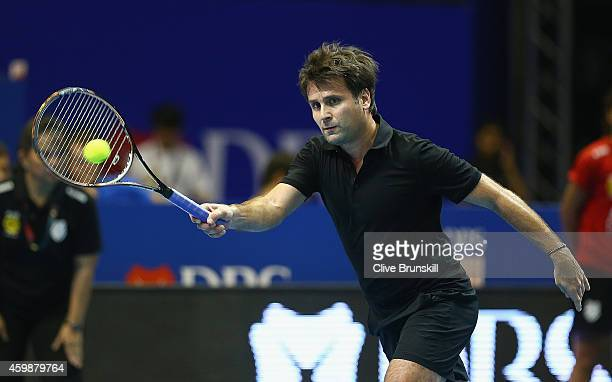 Fabrice Santoro of the Indian Aces plays a forehand against Andre Agassi of the Singapore Slammers during the CocaCola International Premier Tennis...