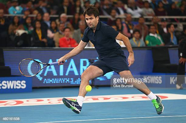 Fabrice Santoro of the Indian Aces plays a forehand against Goran Ivanisevic of the UAE Royals during the CocaCola International Premier Tennis...