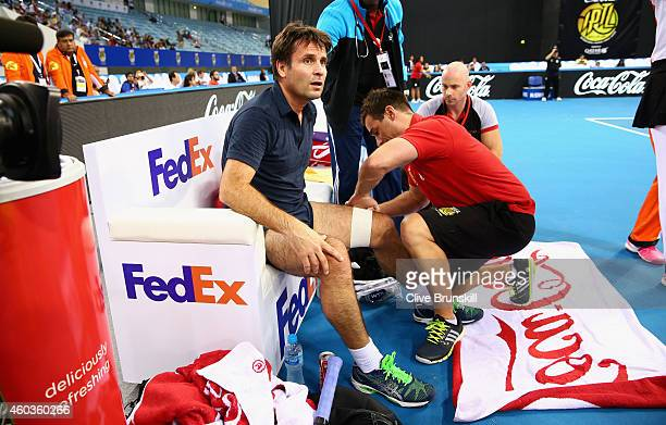 Fabrice Santoro of the Indian Aces receives treatment for an injury during his match against Mark Philippoussis of the Manila Mavericks during the...
