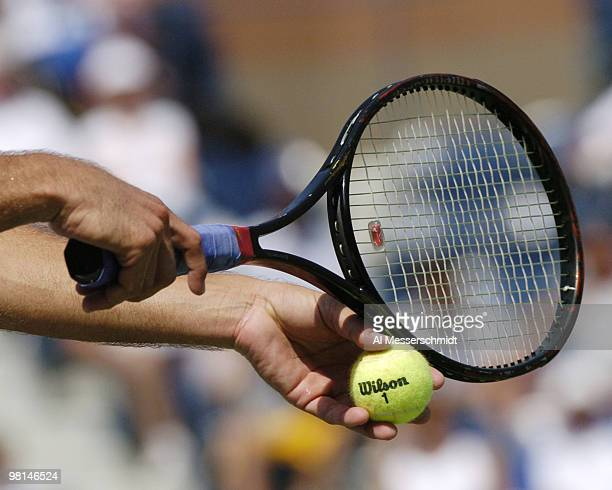Fabrice Santoro sets to serve against Roger Federer in the third round of the men's singles September 4 2004 at the 2004 US Open in New York