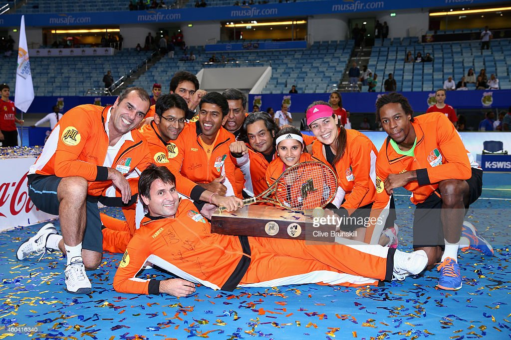 Fabrice Santoro,Ana Ivanovic,Gael Monfils,Sania Mirza,Rohan Bopanna and Cedric Pioline of the Indian Aces pose for a group shot with the trophy after becoming winners of the first IPTL Tour during the Coca-Cola International Premier Tennis League fourth leg at the Hamdan Sports Complex, December 13, 2014 in Dubai.