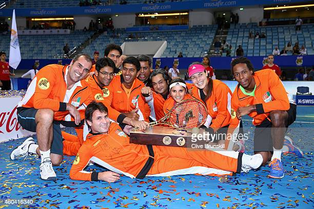Fabrice SantoroAna IvanovicGael MonfilsSania MirzaRohan Bopanna and Cedric Pioline of the Indian Aces pose for a group shot with the trophy after...
