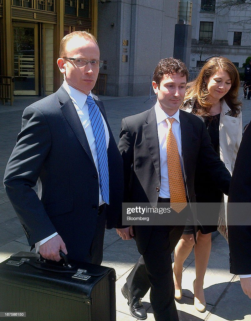Fabrice Tourre, former Goldman Sachs Group Inc. executive, center, exists federal court in New York, U.S., on Friday, April, 26, 2013. Tourre lost a bid to bar a recorded 2007 phone call from a July 15 trial of U.S. Securities and Exchange Commission claims that he misled investors in a collateralized debt obligation. Photographer: Bob Van Voris/Bloomberg via Getty Images