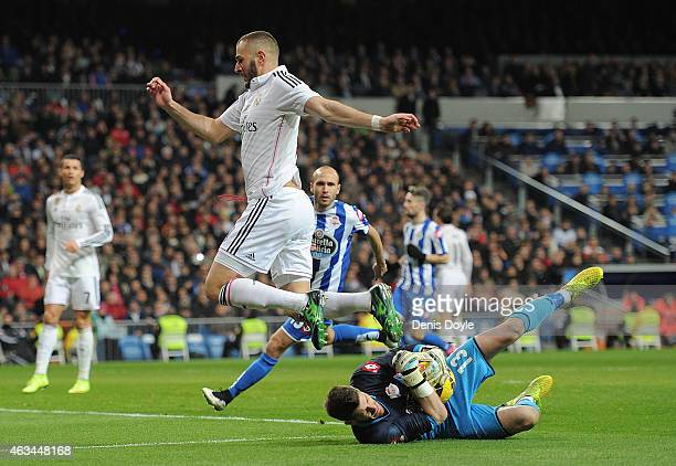 Fabricio Agosto ''Fabri'' of RC Deportivo La Coruna takes the ball from Karim Benzema of Real Madrid during the La Liga match between Real Madrid CF...