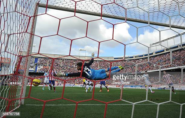 Fabricio Agosto of RC Deportivo La Coruna fails to stop Club Atletico de Madrid from scoring their first goal during the La Liga match between Club...