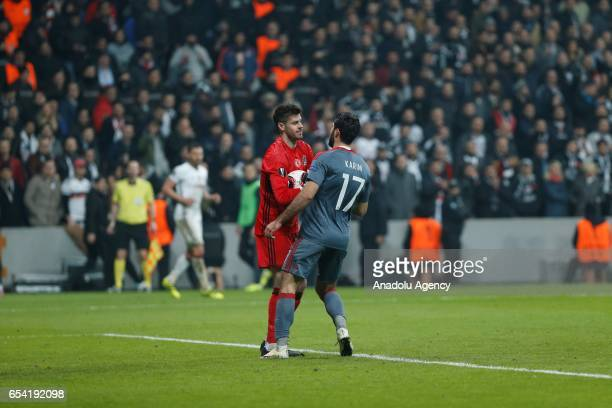 Fabricio Agosto Ramirez of Besiktas in action against Karim Ansarifard of Olympiacos during the UEFA Europa League Round 16 secondleg match between...