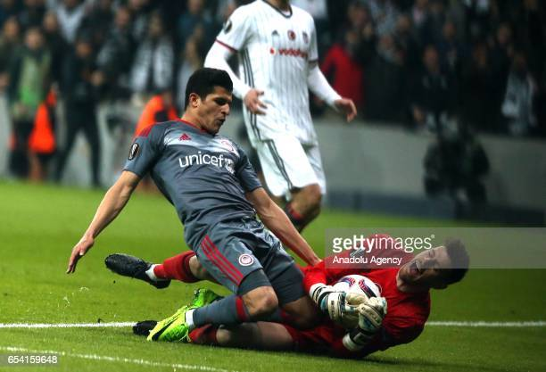 Fabricio Agosto Ramirez of Besiktas in action against Marko Marin of Olympiacos during the UEFA Europa League Round 16 secondleg match between...