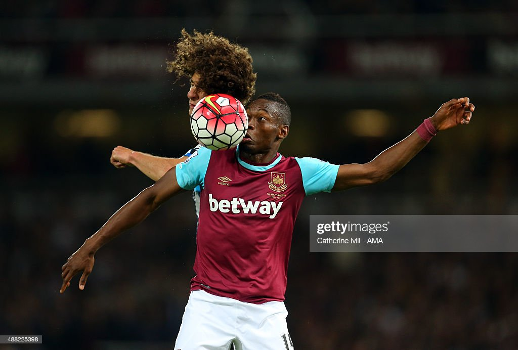 Fabricio Coloccini of Newcastle United and Diafra Sakho of West Ham United during the Barclays Premier League match between West Ham United and Newcastle United on September 14, 2015 in London, United Kingdom.