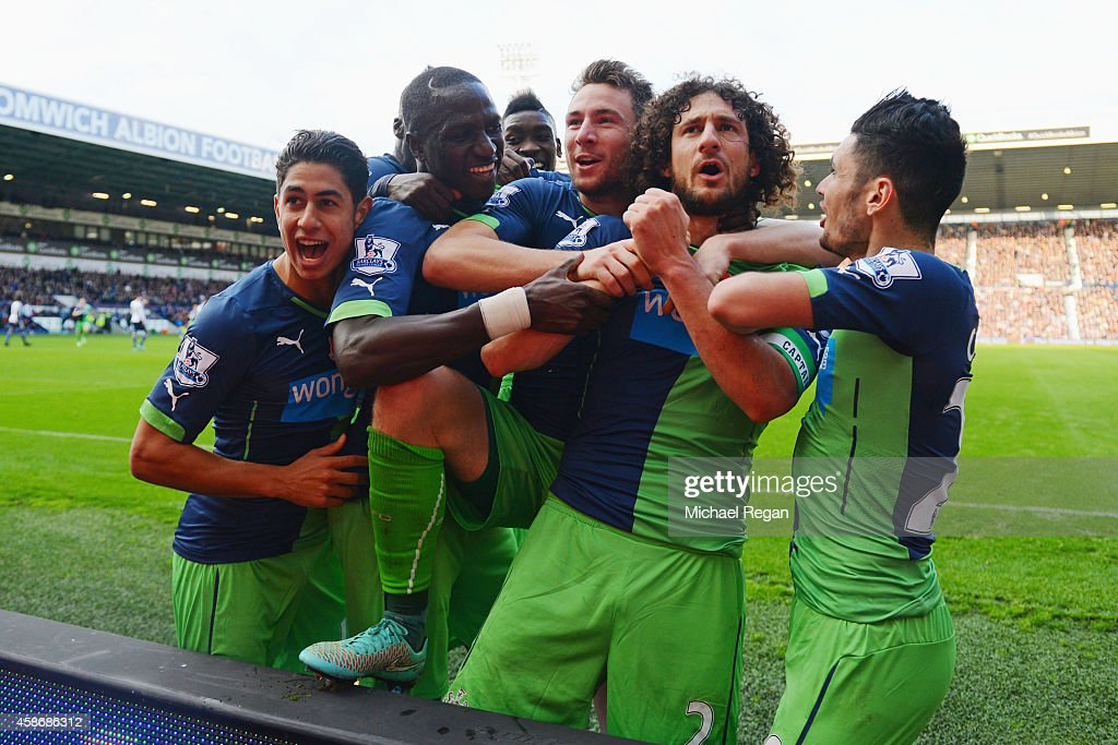 Fabricio Coloccini of Newcastle United celebrates with team mates as he scores their second goal during the Barclays Premier League match between...
