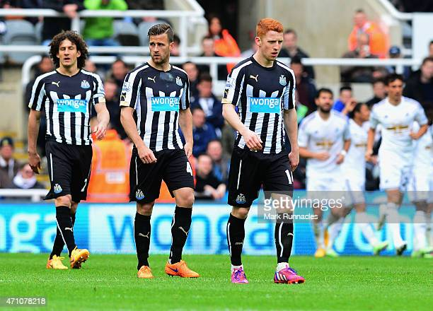 Fabricio Coloccini Ryan Taylor and Jack Colback of Newcastle United walk back to the half way line after the second goal during the Barclays Premier...