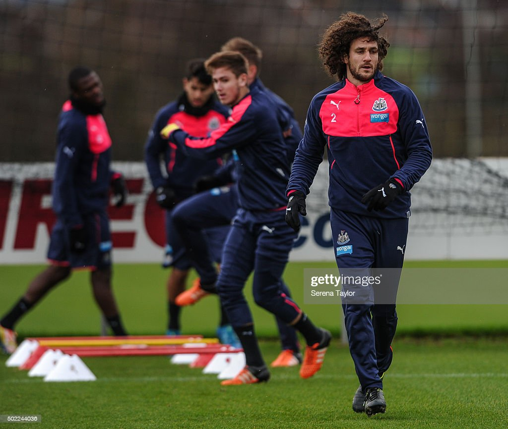 Fabricio Coloccini (R) warms up during the Newcastle United Training session at The Newcastle United Training Centre on December 22, 2015, in Newcastle upon Tyne, England.