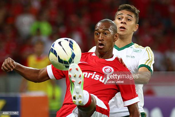Fabricio of Internacional battles for the ball against Victor Luis of Palmeiras during the match between Internacional and Palmeiras as part of...