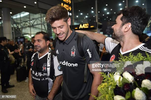 Fabricio Ramirez of Besiktas is greeted by fans during Besiktas team's arrival at Guangzhou International Airport ahead of the 2017 International...