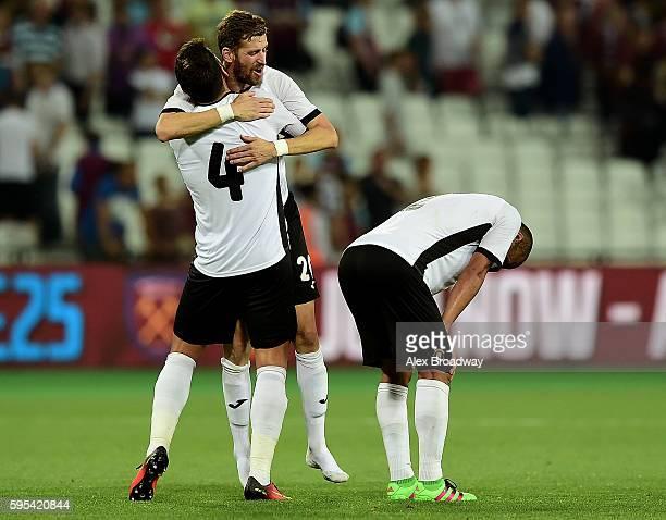 Fabricio Silva Dornellas and Florin Lovin of FC Astra Giurgiu celebrate following the UEFA Europa League match between West Ham United and FC Astra...