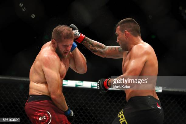 Fabricio Werdum of Brazil punches Marcin Tybura of Poland in their heavyweight bout during the UFC Fight Night at Qudos Bank Arena on November 19...