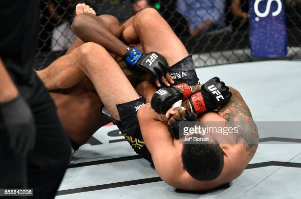 Fabricio Werdum of Brazil secures an arm bar submission against Walt Harris in their heavyweight bout during the UFC 216 event inside TMobile Arena...