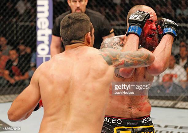 Fabricio Werdum punches Travis Browne in their heavyweight bout during the FOX UFC Saturday event at the Amway Center on April 19 2014 in Orlando...