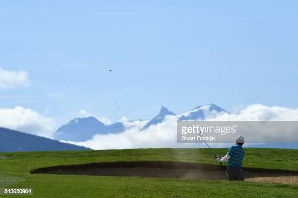 Fabricio Zanotti of Paraguay plays out of a bunker on the 7th during day one of the 2017 Omega European Masters at CranssurSierre Golf Club on...