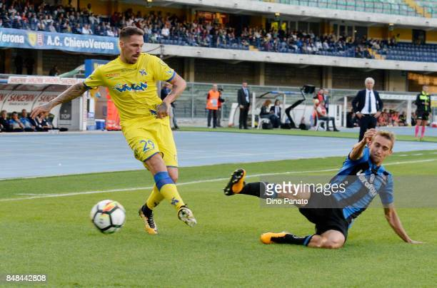 Fabrizio Cacciatore of AC Chievo Verona competes with Marten de Roon of Atalanta BC during the Serie A match between AC Chievo Verona and Atalanta BC...