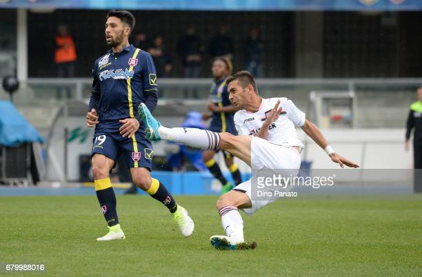 Fabrizio Cacciatore of AC ChievoVerona competes with Ivaylo Chocev of US Citta di Palermo during the Serie A match between AC ChievoVerona and US...