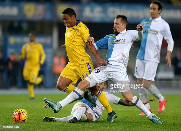 Fabrizio Cacciatore of Chievo Verona competes with Luis Muriel of UC Sampdoria during the Serie A match between AC Chievo Verona and UC Sampdoria at...
