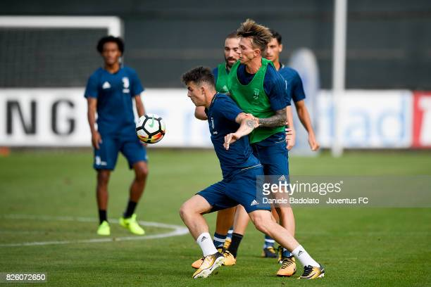 Fabrizio Caligara and Federico Bernardeschi of Juventus during a training session on August 3 2017 in Vinovo Italy