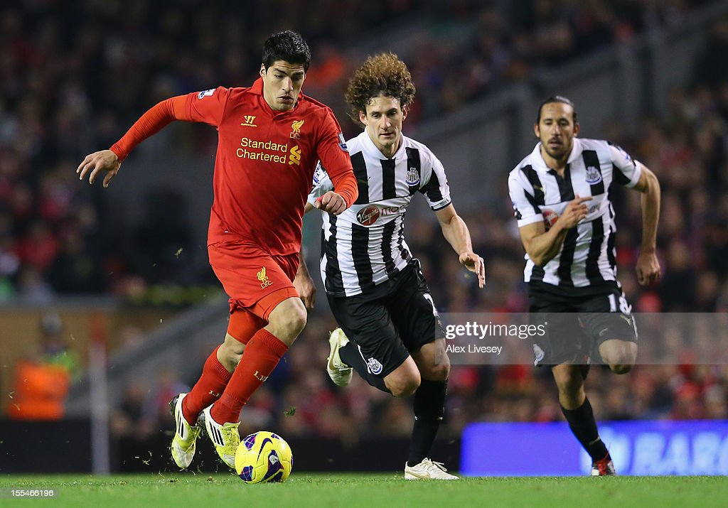 Fabrizio Coloccini of Newcastle United competes with Luis Suarez of Liverpool during the Barclays Premier League match between Liverpool and Newcastle United at Anfield on November 4, 2012 in Liverpool, England.