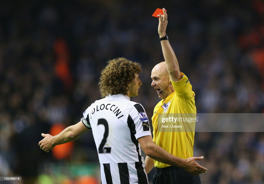 Fabrizio Coloccini of Newcastle United is shown a red card by Referee Anthony Taylor during the Barclays Premier League match between Liverpool and Newcastle United at Anfield on November 4, 2012 in Liverpool, England.