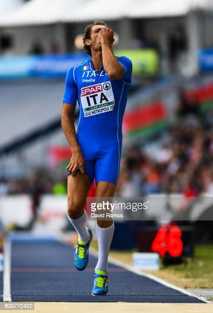 Fabrizio Donato of Italy reacts after falling injured competing in the Men's Triple Jump Final during day three of the European Athletics Team...
