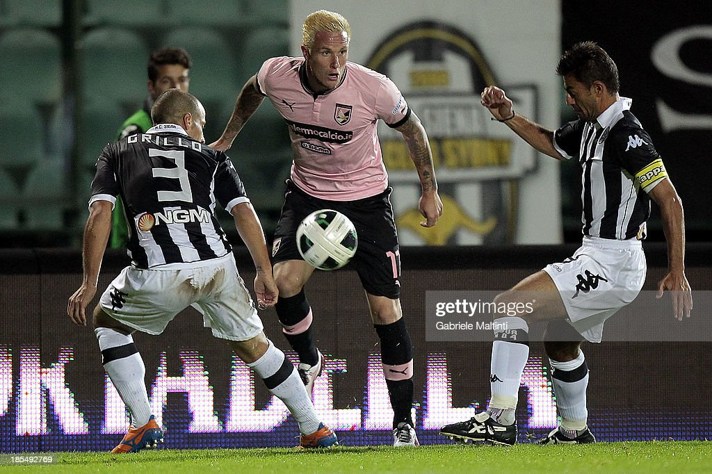 Fabrizio Grillo and Simone Vergassola of AC Siena fights for the ball with Michel Morganella of US Citta' di Palermo during the Serie B match between AC Siena and US Citta di Palermo at Artemio Franchi - Mps Arena on October 21, 2013 in Siena, Italy.
