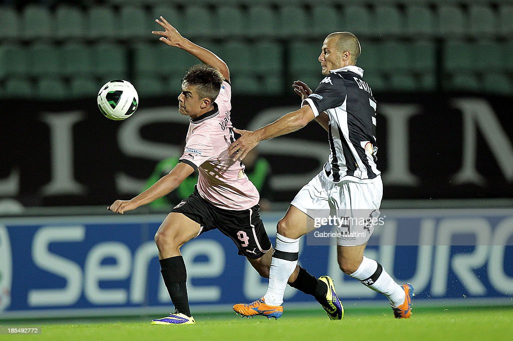 Fabrizio Grillo of AC Siena fights for the ball with Paulo Dybala of US Citta' di Palermo during the Serie B match between AC Siena and US Citta di Palermo at Artemio Franchi - Mps Arena on October 21, 2013 in Siena, Italy.