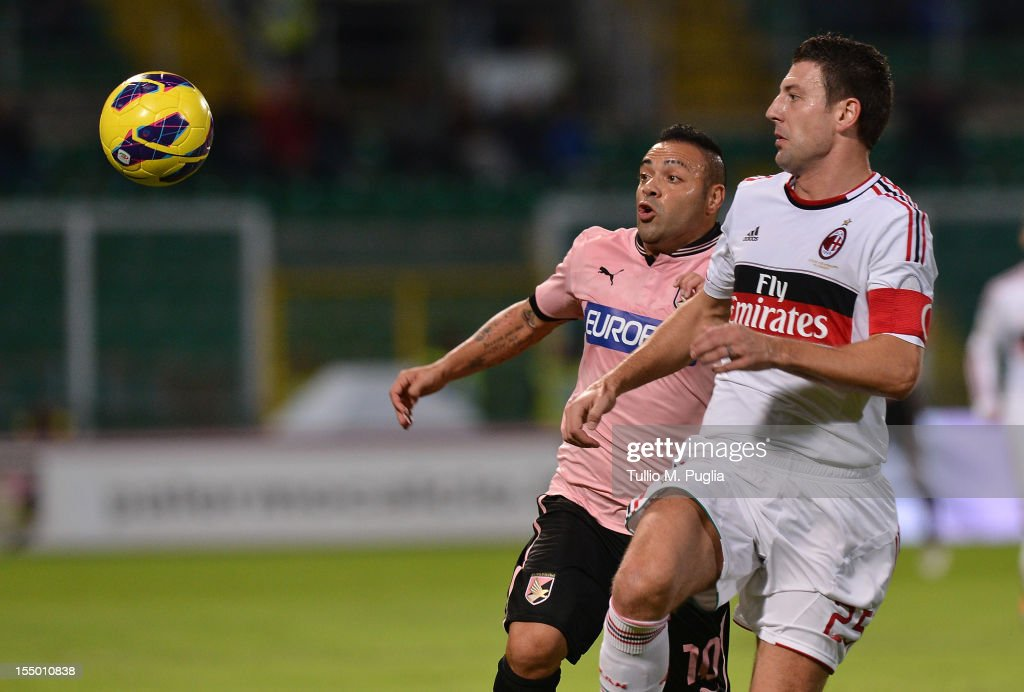 <a gi-track='captionPersonalityLinkClicked' href=/galleries/search?phrase=Fabrizio+Miccoli&family=editorial&specificpeople=702434 ng-click='$event.stopPropagation()'>Fabrizio Miccoli</a> (L) of Palermo and <a gi-track='captionPersonalityLinkClicked' href=/galleries/search?phrase=Daniele+Bonera&family=editorial&specificpeople=615708 ng-click='$event.stopPropagation()'>Daniele Bonera</a> of Milan compete for the ball during the Serie A match between US Citta di Palermo and AC Milan at Stadio Renzo Barbera on October 30, 2012 in Palermo, Italy.