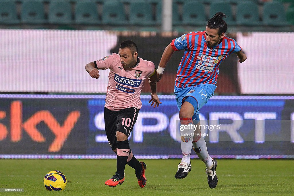 Fabrizio Miccoli (L) of Palermo and Nicolas Spolli of Catania compete for the ball during the Serie A match between US Citta di Palermo and Calcio Catania at Stadio Renzo Barbera on November 24, 2012 in Palermo, Italy.